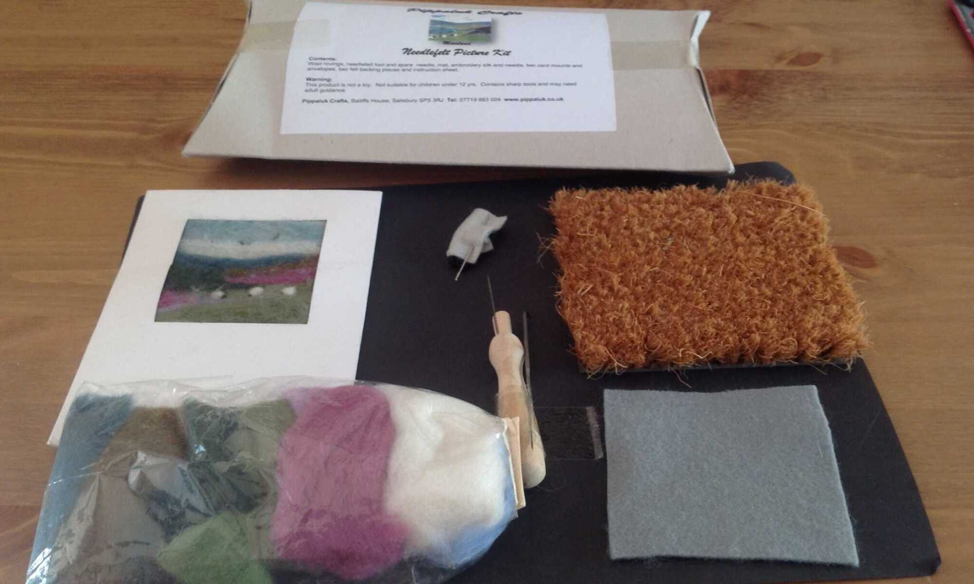 Create a needle felt picture of a moorland scene