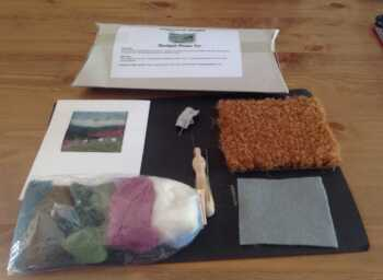 Create a needle felt picture of a moorland scene